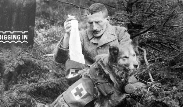 WW1 soldier with dog in forest