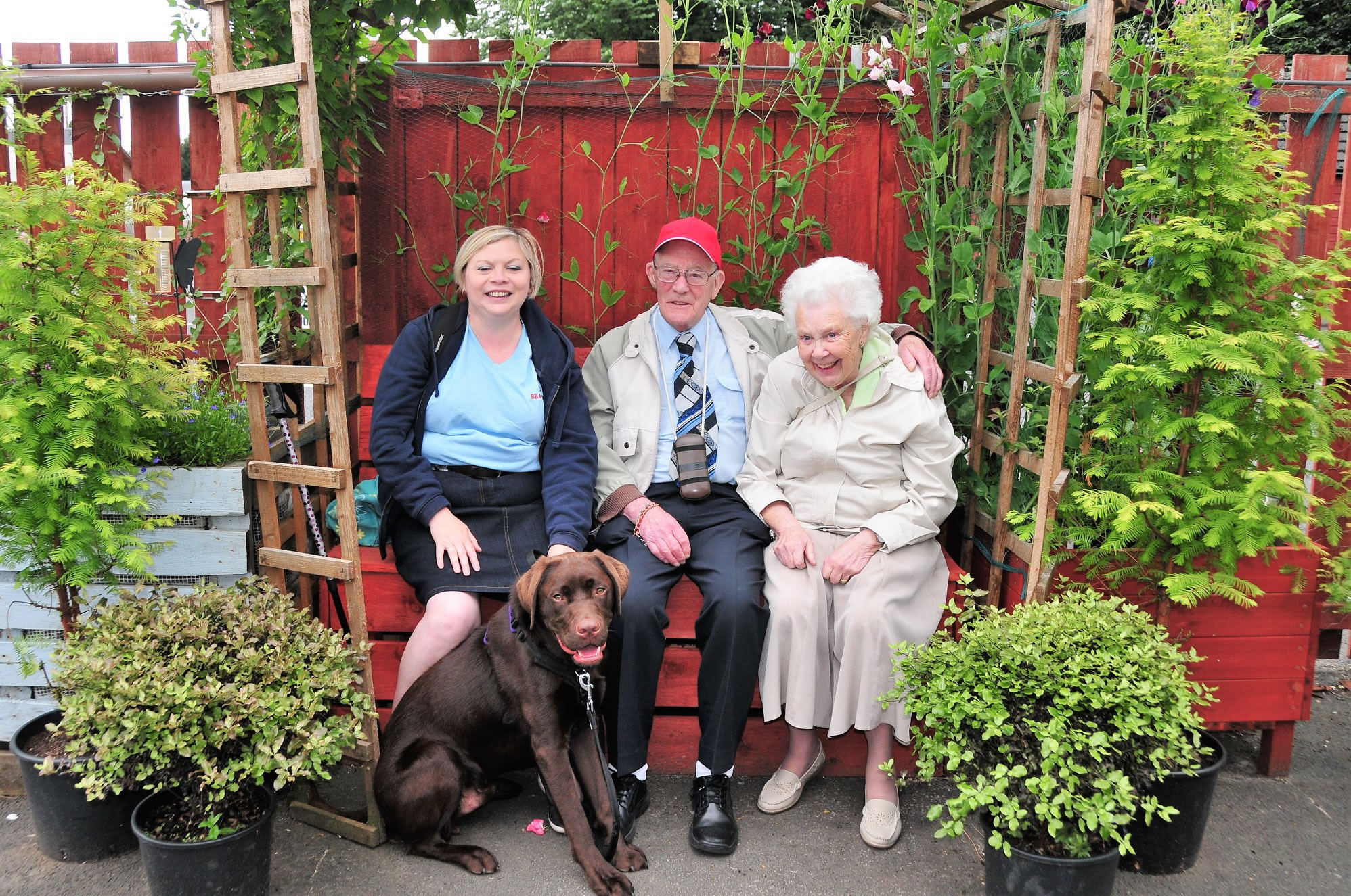 lady with dog and elderly couple