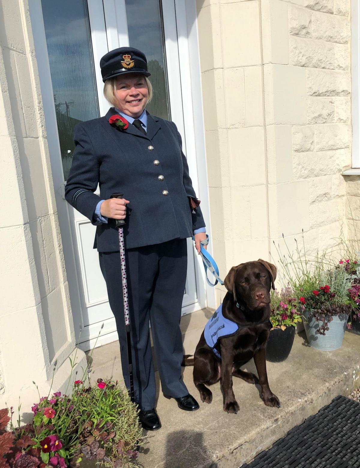 army lady with dog
